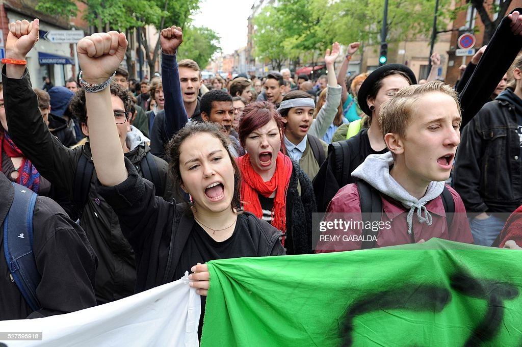 People demonstrate against the government's planned labour reform, on May 3, 2016 in Toulouse. / AFP / REMY
