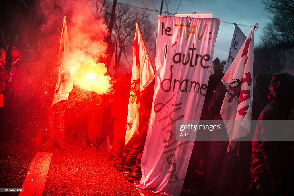 People demonstrate against the new LGV Lyon-Turin project, on December 3, 2012 in Lyon, on the sideline of the 30th France-Italy annual summit.