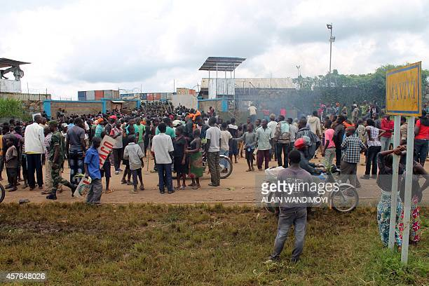 People demonstrate against the UN mission MONUSCO in Mavivi north of Beni on October 22 2014 as two people were killed and another was severely...