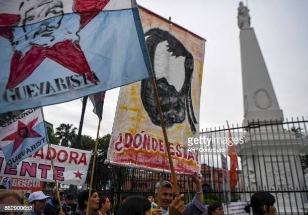 People demonstrate at the Plaza de Mayo square in Buenos Aires on October 18 a day after the discovery of a body thought to be that of missing...