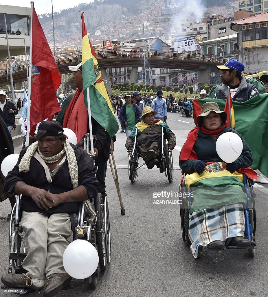 People demonstrate in demand of a raise in the subsidy for the disabled, in La Paz, on May 5, 2016. The demonstrators, who have been staging protests for more than a week, are demanding the government of Bolivian President Evo Morales that the subsidy for people with disabilities -- currently at 80 Bolivian pesos (about 11 US dollars) -- is raised to 500 pesos (about 72 US dollars). / AFP / AIZAR