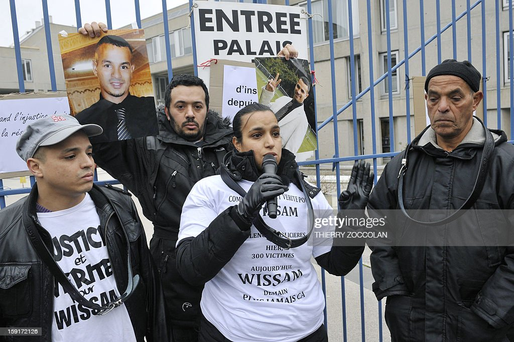 People demonstrate in front of Clermont-Ferrand's courthouse, on January 1, 2013, to call for 'the truth' regarding the death of Wissam el-Yamni (picture), following his arrest one year ago. AFP PHOTO THIERRY ZOCCOLAN