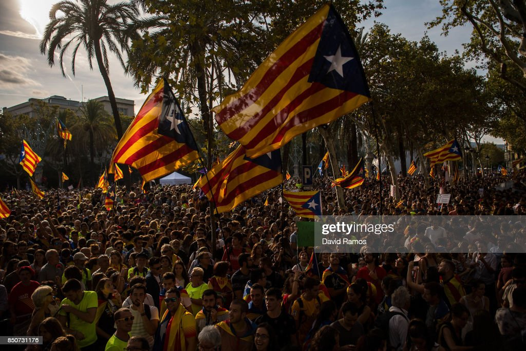 People demonstrate in front of the Catalan High Court building on September 21, 2017 in Barcelona, Spain. Pro-Independence Associations called for a meeting in front of the Catalan High Court building demanding release of the 14 officials arrested yesterday during a Spanish Police operation in an attempt to stop the region's independence referendum, due to take place on October 1, which has been deemed illegal by the Spanish government in Madrid.