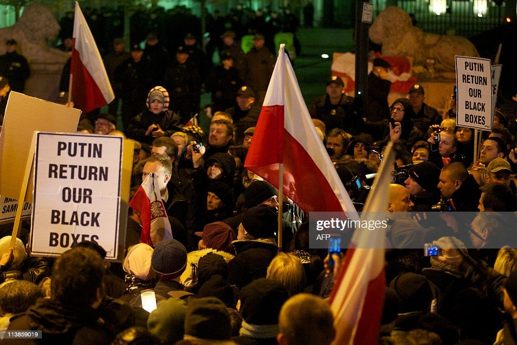 People demonstrate in front of the Presidential Palace in Warsaw on April 10 during a memorial service commemorating the first anniversary of a plane...