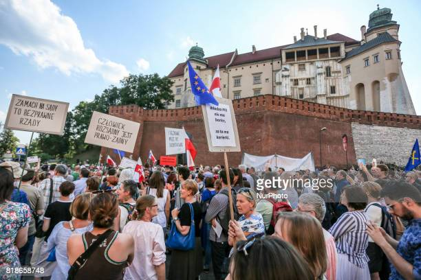 People demonstrate in front of Wawel Castel during another day of protests against government plans for sweeping changes to Polands judicial system...