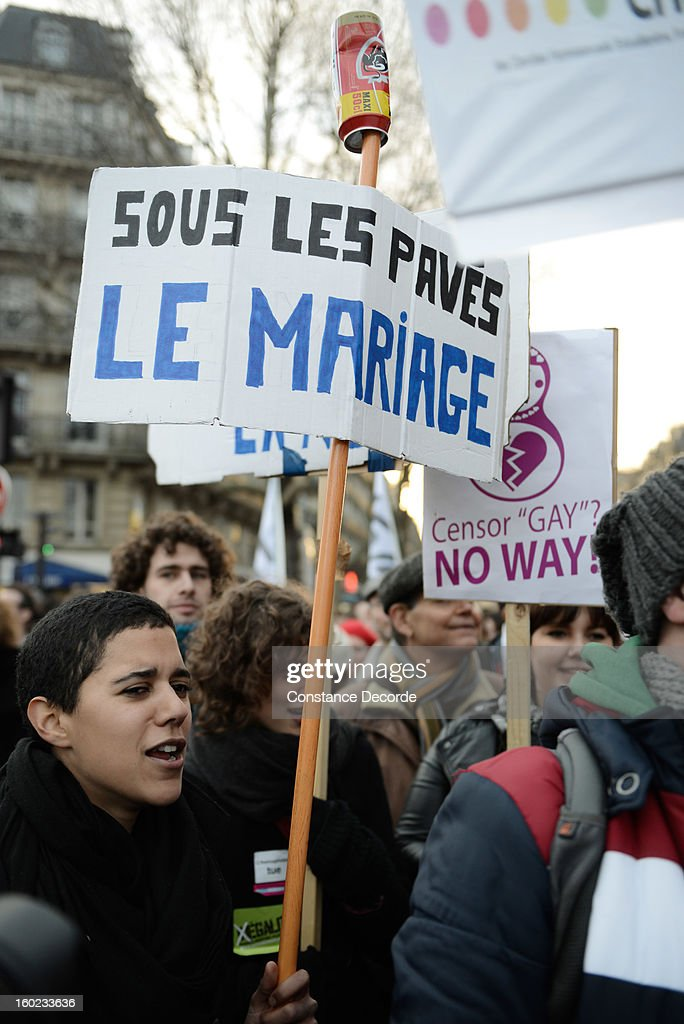 People demonstrate in support for the marriage for all on January 28, 2013 in Paris, France. The marriage equality bill, which will be debated at the French National Parliament, would not only legalize same-sex marriage and also allow gay couples to adopt, a controversial issue in the bill. French President Francois Hollande supports the legislation but faces criticism from anti-gay and religious groups, while gay rights groups have concerns of inadequacies within the bill.