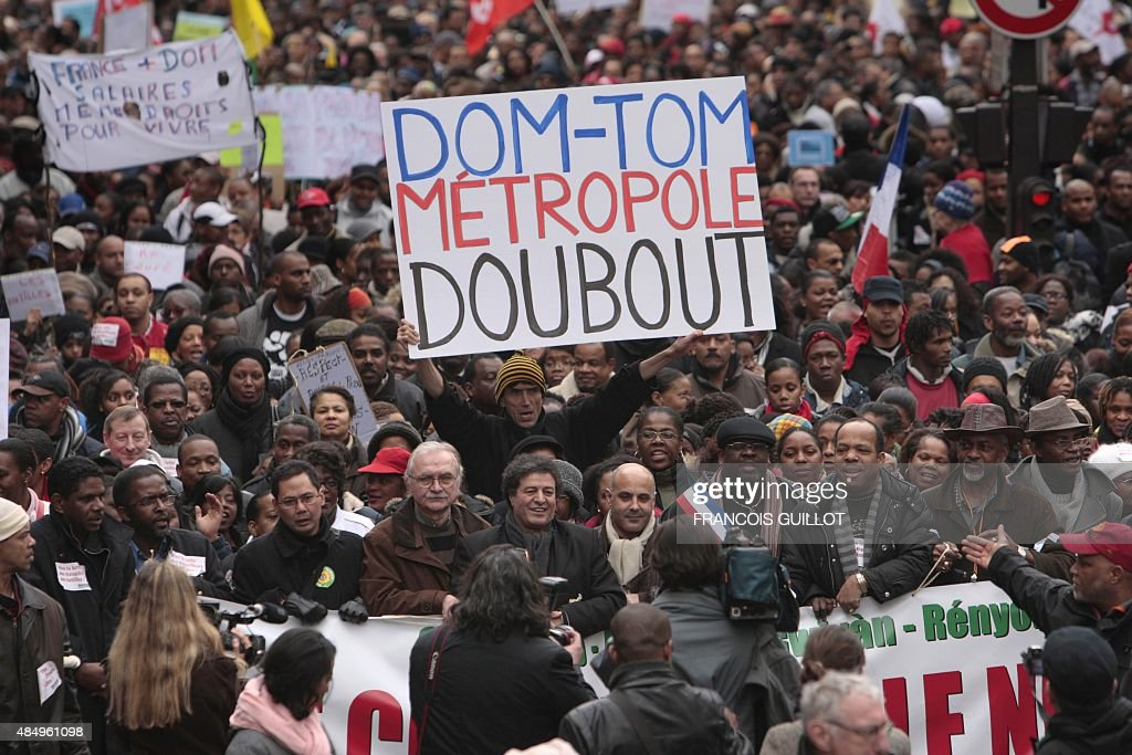 People demonstrate on February 21 2009 in Paris during a rally called by the 'Collectif des originaires d'outremer' in support of residents in French...