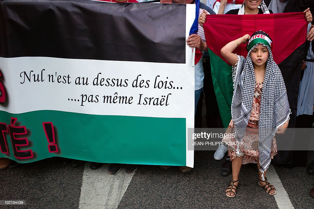 People demonstrate on June 5, 2010 in Lyon, to protest Israel's storming of a Gaza-bound aid flotilla that left nine pro-Palestinian activists dead, as another ship was expected to try to break the Israeli blockade of Gaza. Banner reads : 'None is above the law, not even Israel'.