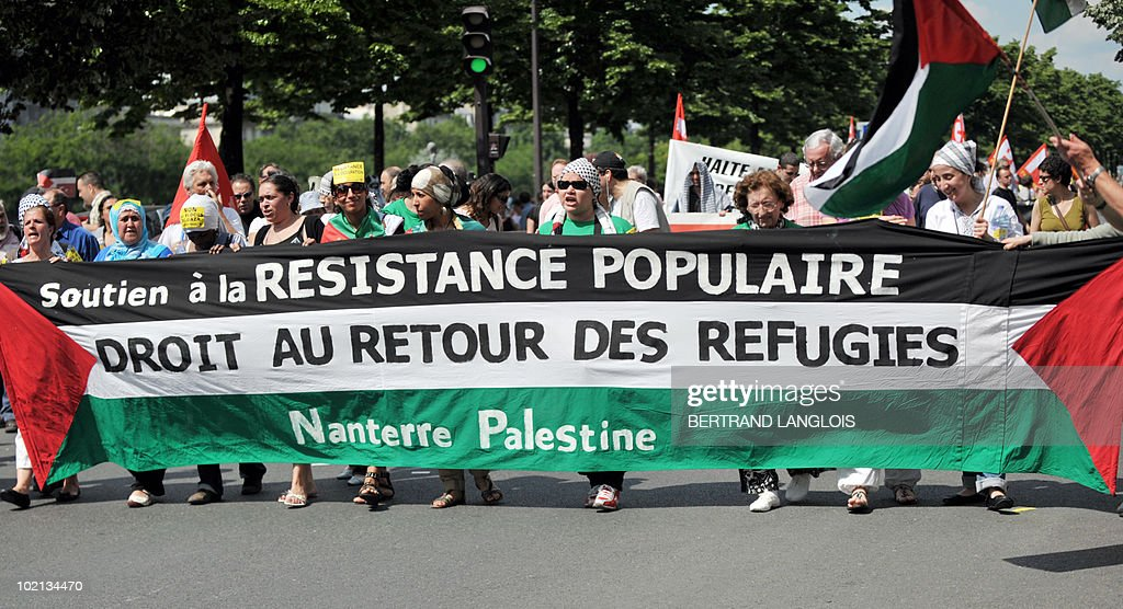 People demonstrate on June 5, 2010 in Paris, to protest Israel's storming of a Gaza-bound aid flotilla that left nine pro-Palestinian activists dead, as another ship was expected to try to break the Israeli blockade of Gaza. Banner reads : 'Support to the popular resistance. Refugees' return.'