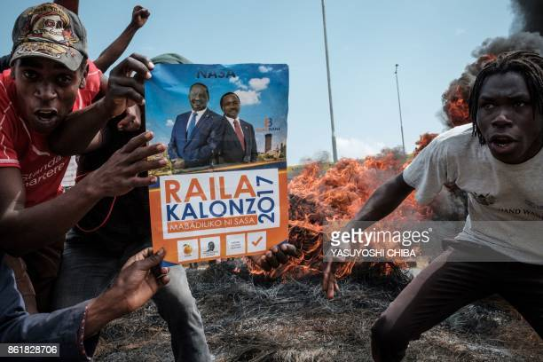 TOPSHOT People demonstrate on October 16 2017 in Kisumu to demand the removal of officials from national election oversight body Interim Elections...