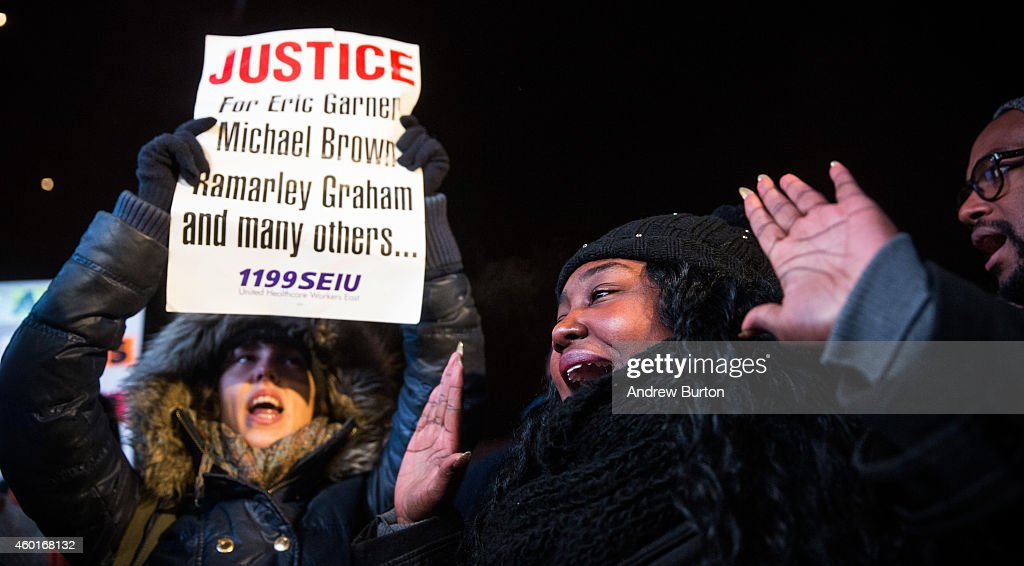 People demonstrate outside the Barclays Center during a Brooklyn Nets game to protest a Staten Island New York grand jury's decision not to indict a...