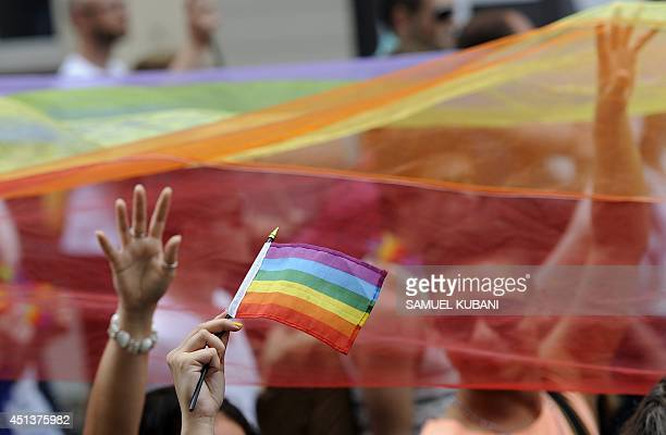 People demonstrate with rainbow flags during the lesbian gay bisexual and transgender Rainbow Pride Parade in Bratislava Slovakia on June 28 2014 AFP...