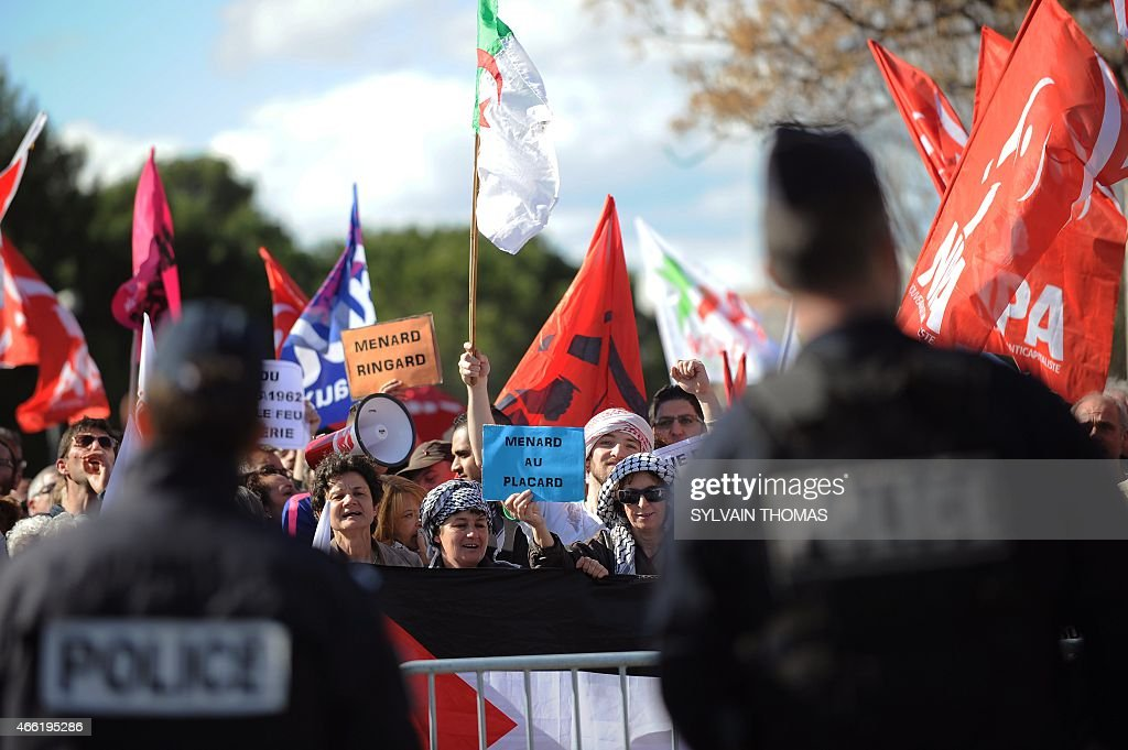 People demonstrates against the unveiling by Beziers Mayor supported by the French far-right Front National party (FN - National Front), <a gi-track='captionPersonalityLinkClicked' href=/galleries/search?phrase=Robert+Menard&family=editorial&specificpeople=554783 ng-click='$event.stopPropagation()'>Robert Menard</a> (UNSEEN), of a renamed street name sign 'rue du commandant Helie Denoix de Saint-Marc', who took part in the Algiers putsch of 1961, on March 14, 2015 in Bezier, southern France. The street was previsouly named 'rue du 19 mars 1962' (March 1962 street), the date of the Evian Accords, which ended the Algerian War.