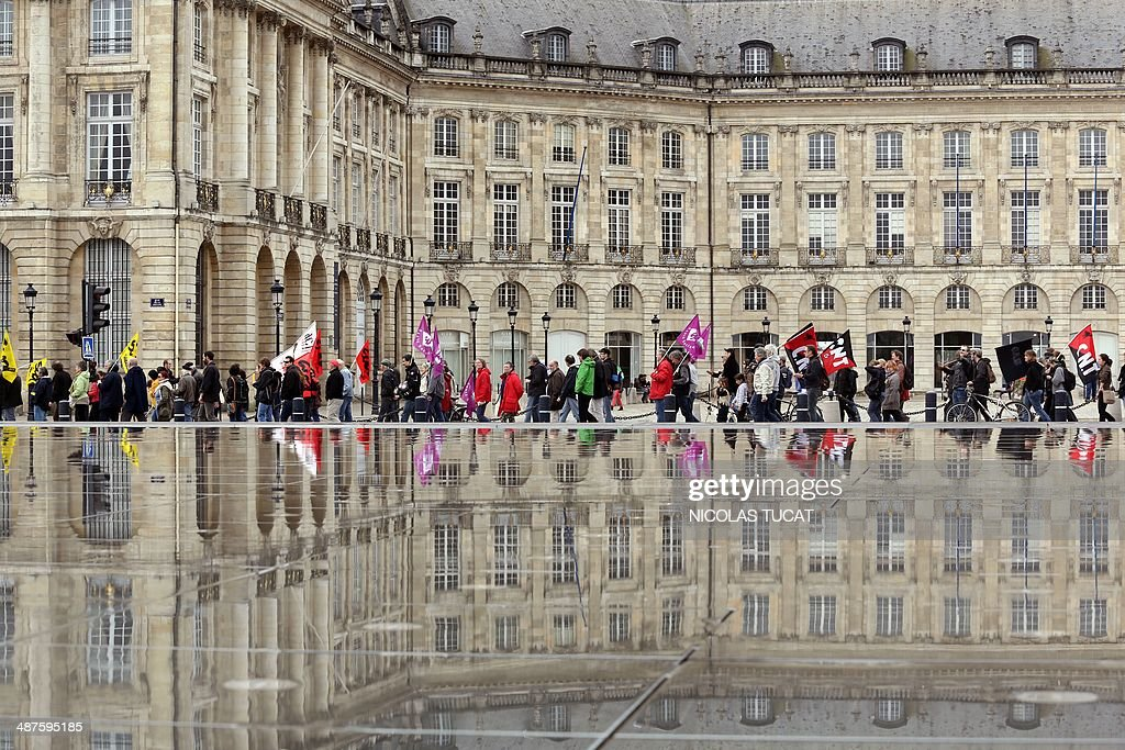 People demonstrates along the reflecting pool at the Place de la Bourse in Bordeaux western France during a May Day rally on May 1 2014 AFP PHOTO /...