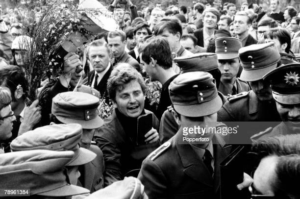 26th May 1968 French born student leader Daniel CohnBendit clutches his passport at the GermanFrench frontier as he attempts to reenter France from...