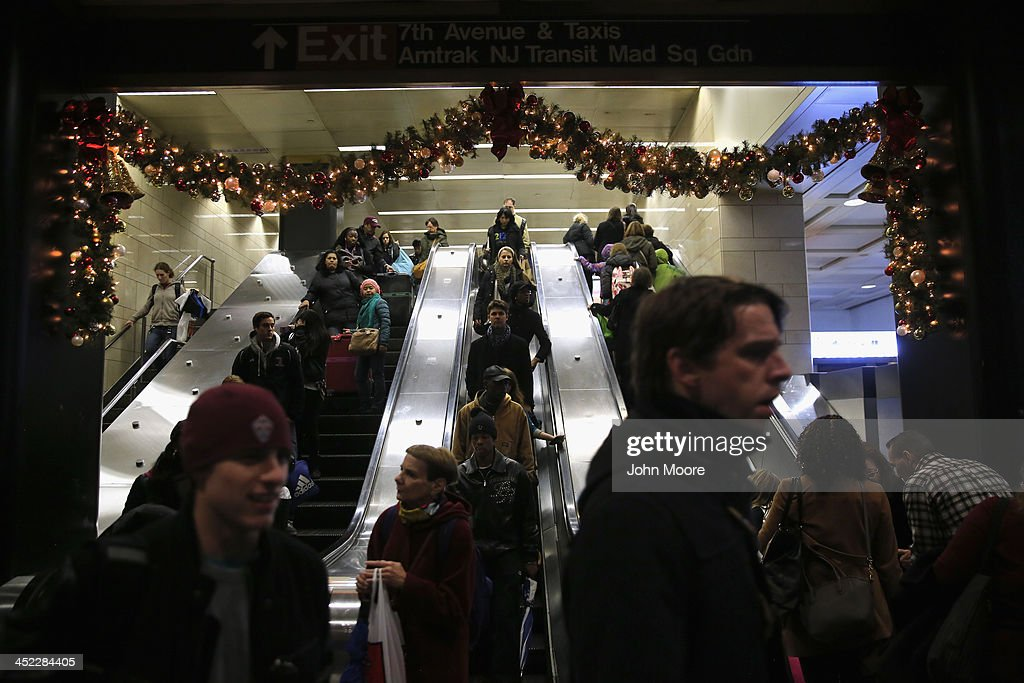 People descend into Pennsylvania Station to board trains on the busiest travel day of the year November 27, 2013 in New York City. Even on an average day, some 650,000 people transit through Penn Station twice as many as America's most-used airport in Atlanta and busier than the New York area's three major airports combined.