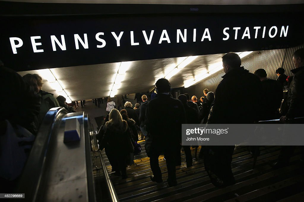 People descend into Pennsylvania Station to board trains on the busiest travel day of the year November 27, 2013 in New York, United States. Even on an average day, some 650,000 people transit through Penn Station twice as many as America's most-used airport in Atlanta and busier than the New York area's three major airports combined.