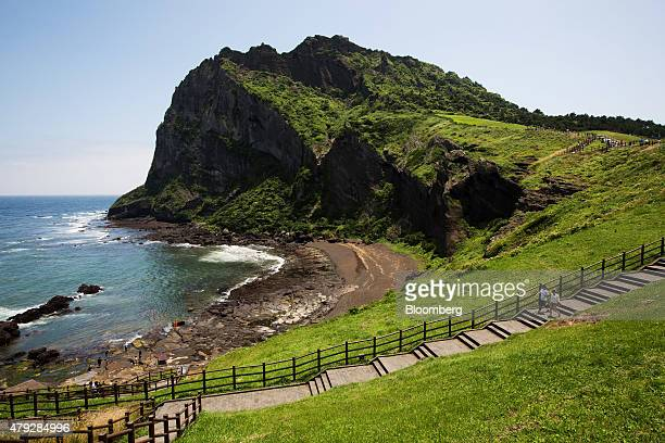 People descend stairs at Seongsan Ilchulbong in Seogwipo Jeju South Korea on Sunday June 28 2015 South Koreaâs 15 trillion won extra budget will...