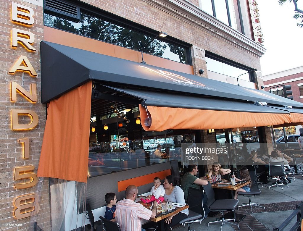 People dine at Brand 158 restaurant in Glendale California on May 1 2014 The restaurant does not accept tips A number of restaurants across the US...