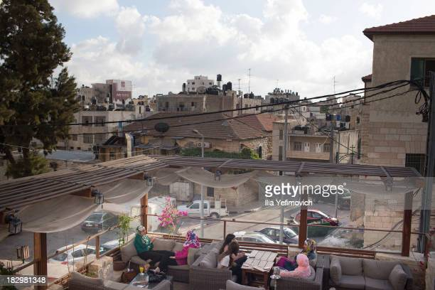 People dine outside at a restaurant on September 19 2013 in Ramallah WestBank The West Bank and Gaza Strip are inhabited by an estimated 333 million...