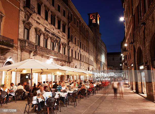 People dining along Corso Vannucci at night