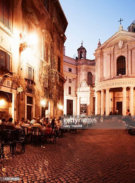 People dining outside Restaurants at dusk