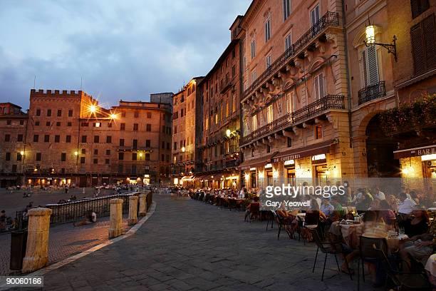 People dining outside Restuarants at dusk