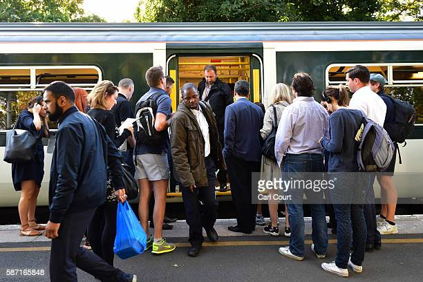 People disembark and wait to board a train on the hugelyreduced Southern rail service at East Dulwich station on August 8 2016 in London England...