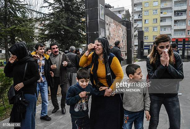 People disperse as Turkish police fire tear gas in Diyarbakir on February 27 2016 during a demonstration against governmentimposed curfews on areas...