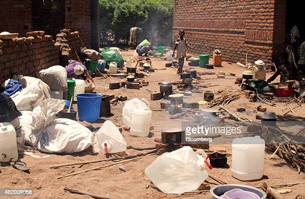 People displaced by floods in southern Malawi cook food at a relocation camp at Tidzora 80 kilometers west of the commercial capital Blantyre Milawi...