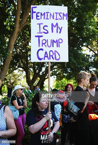 People display banners in Hyde Park on January 21 2017 in Sydney Australia The marches in Australia were organised to show solidarity with those...