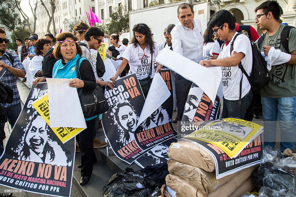 People displays placards during a march on the streets of Lima's downtown to protest against Presidential Candidate Keiko Fujimori on May 31, 2016 in Lima, Peru. Fujimori will be competing for Peru's Presidency on the second round of the electoral voting next June 5th.
