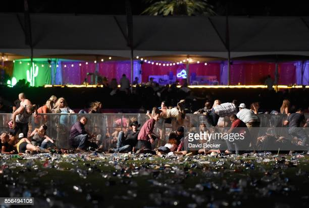 People dive for cover at Route 91 Harvest country music festival after apparent gun fire was heard on October 1 2017 in Las Vegas Nevada There are...