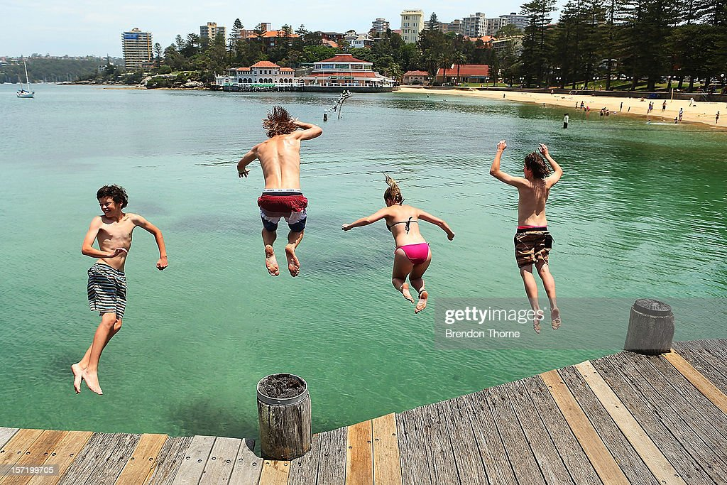 People dive off Manly Wharf on November 30, 2012 in Sydney, Australia. Temperatures in the high 30s and low 40s are expected to hit parts of the state over the weekend.