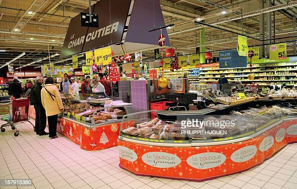 People do their shopping at an Auchan supermarket in FachesThumesnil on December 6 2012 AFP PHOTO PHILIPPE HUGUEN