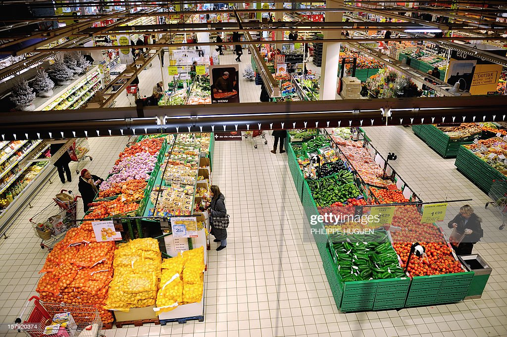 People do their shopping at an Auchan supermarket in Faches-Thumesnil on December 6, 2012.