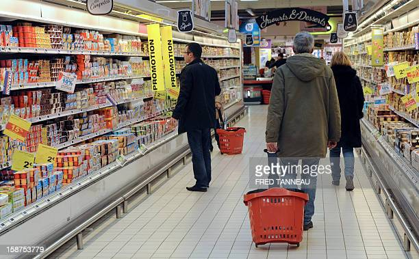 People do their shopping in a supermarket Auchan on December 27 2012 in SaintSebastiensurLoire western France AFP PHOTO / FRED TANNEAU