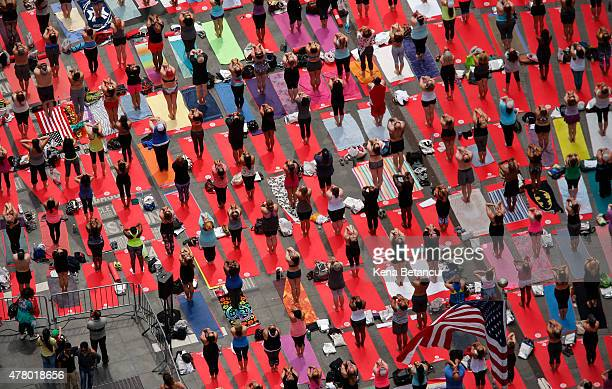 People do yoga in Times Square as part of the International Day of Yoga celebration on the Summer Solstice June 21 2015 in New York City One hundred...