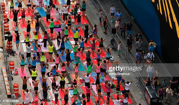 People do yoga in Times Square as part of the International Day of Yoga celebration on the Summer Solstice June 21 2015 in New York City 192...