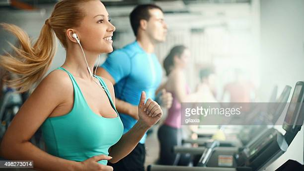 People doing treadmill exercise in a gym,