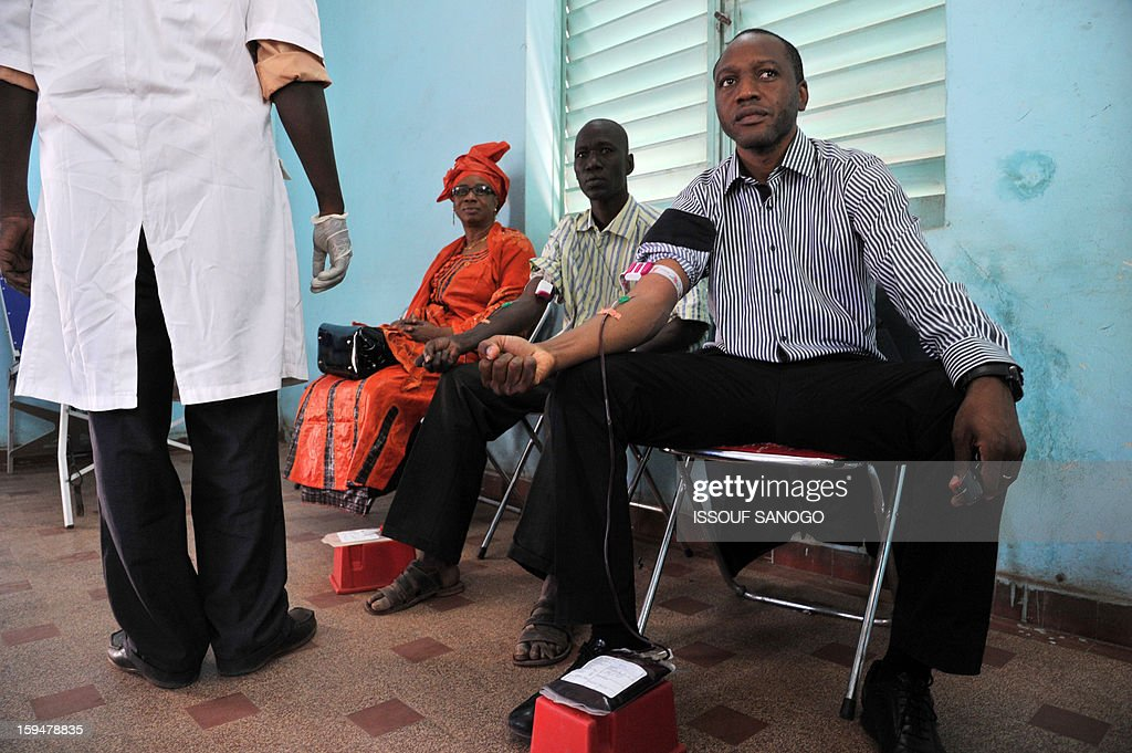 People donate blood for the injured, on January 14, 2013 in Bamako. Islamists have retreated in the east of Mali but French forces are facing a difficult situation in the west of the country where rebels are well armed, French Defence Minister Jean-Yves Le Drian said on January 14. France launched the operation alongside the Malian army on January 11, 2013 to counter a push south by the insurgents who had threatened to advance on the capital Bamako.