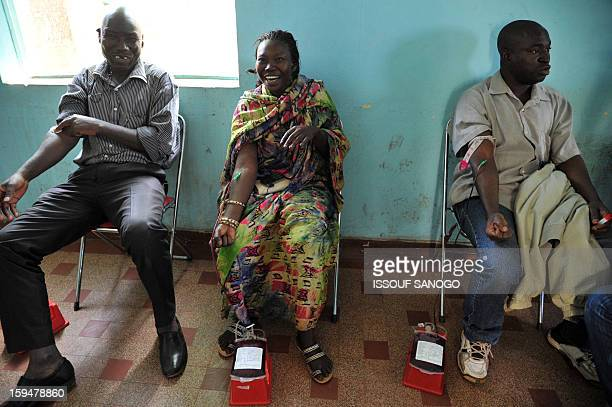 People donate blood for the injured on January 14 2013 in Bamako Islamists have retreated in the east of Mali but French forces are facing a...