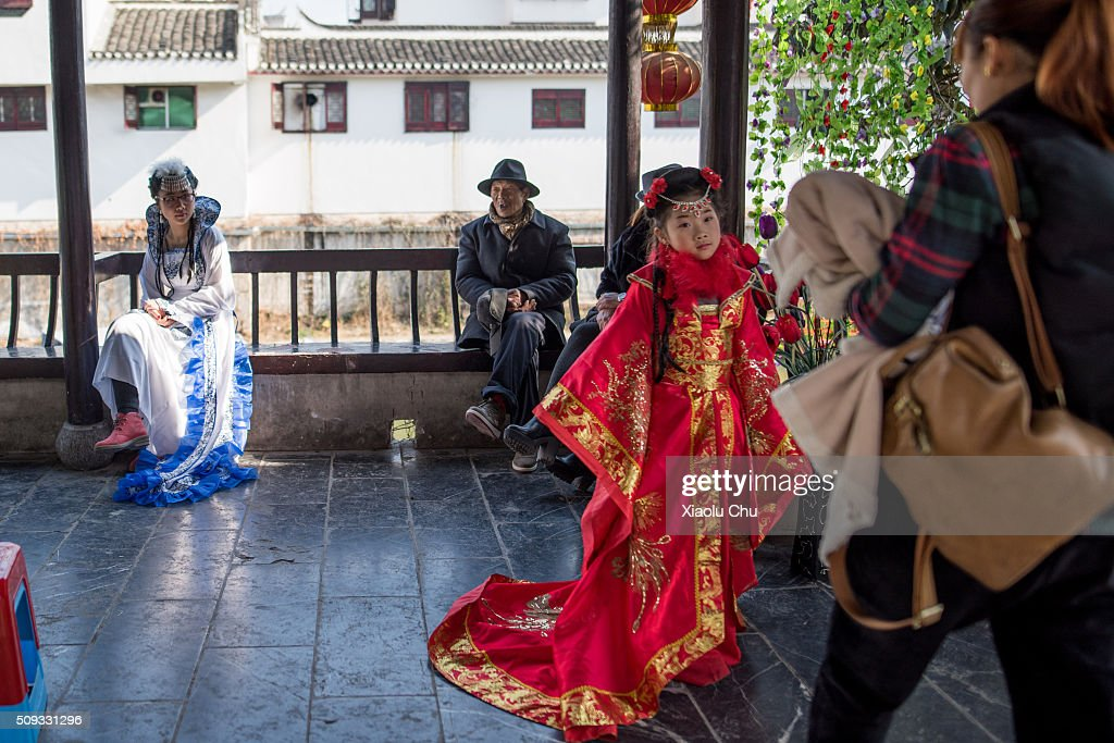 People dress up ancient costume and take pictures during Chinese Spring Festival on February 10, 2016 in Hefei, China. The Spring Festival will be celebrated February 7-16 and is the most important holiday in China.