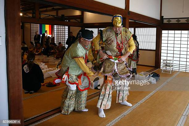 People dressed as 25 Buddhist saints prepare to march at the Chionji temple on April 23 2016 in Kyoto Japan This triannual ceremony which is split...