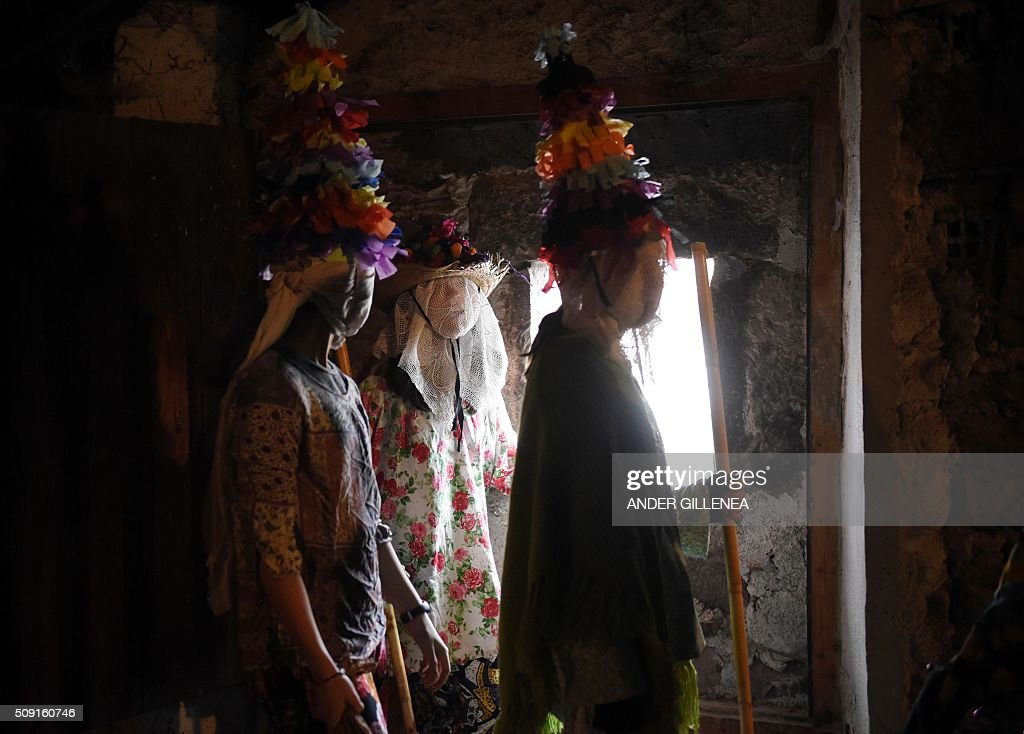 People dressed as a Txatxoak prepare to take part in the ancient carnival of Lantz in the northern Spanish Navarre village of Lantz, on February 9, 2016. / AFP / ANDER GILLENEA