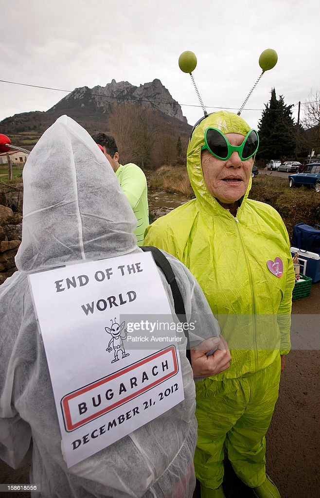 People dressed as aliens after the time passed 11.11 am, the time the Mayan Apocalypse was supposed to occur in Bugarach village on December 21, 2012 in Bugarach, France. The prophecy of an ancient Mayan calendar claimed that today would see the end of the world, and that Burgarach is the only place on Earth which will be saved from the apocalypse.