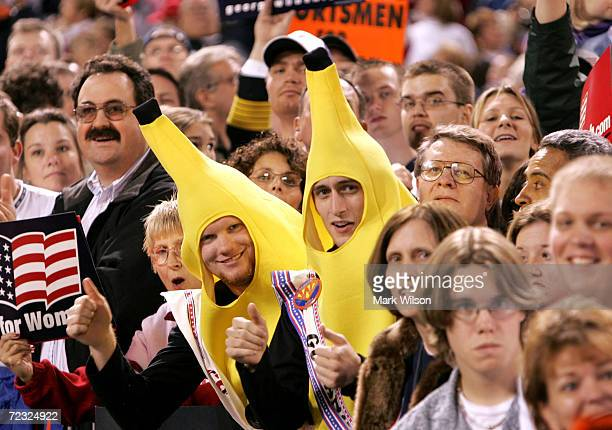 People dressed as bananas listen to US President George W Bush speak during a campaign rally at the Great American Ball Park October 31 2004 in...