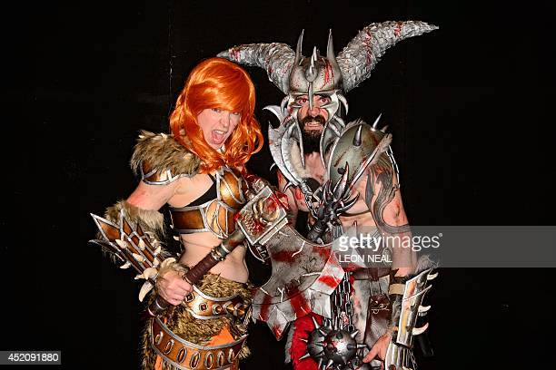People dressed as barbarians from the video game Diablo 3 pose at the London Film and Comic Con 2014 in Earls Court west London on July 13 2014 The...