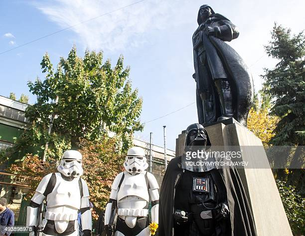 People dressed as characters from 'Star Wars' film take part in an inauguration ceremony of a Darth Vader monument formerly a statue of Soviet...