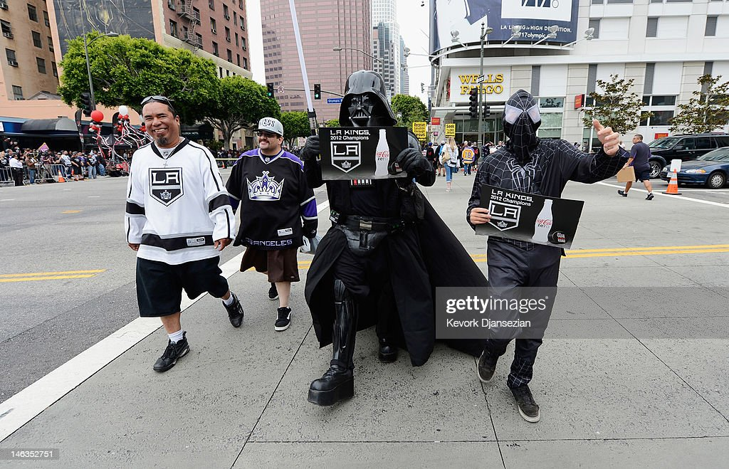 People dressed as Darth Vader and Spiderman arrive for the Stanley Cup victory parade on June 14, 2012 in Los Angeles, California. The Kings are celebrating their first NHL Championship in the team's 45-year-old franchise history.